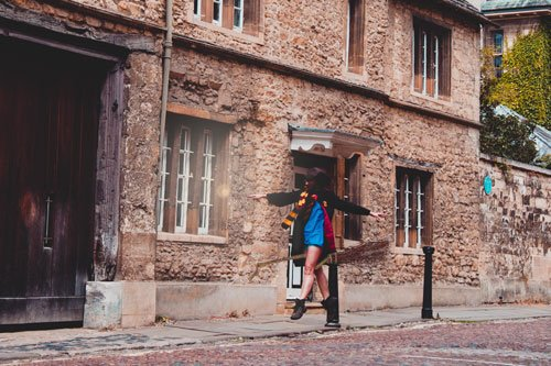 Me dressed as Hermione Granger on a broomstick in Oxford