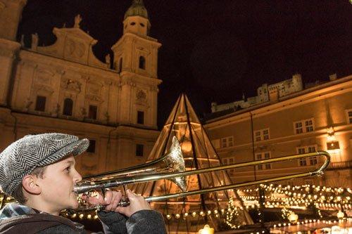 Salzburg Christkindlmarket with kid brass player
