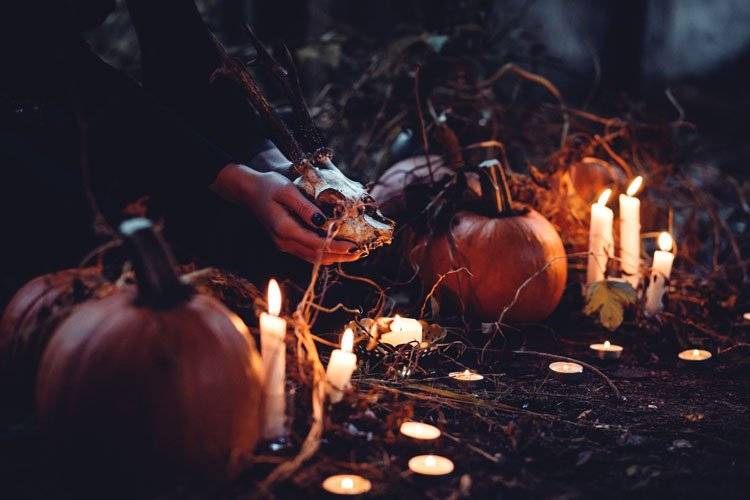 pumpkins and candles ceremony in the dark