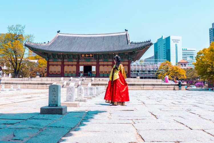 female tourist in royal hanbok at Gyeongbokgung Palace in Seoul