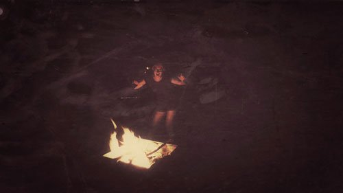 dancing around the fire in Australia at night