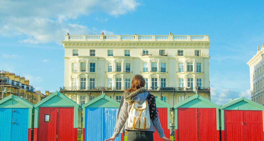 Brighton's famous colourful beach huts along the oceanshore