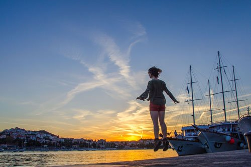 Sunset in Croatia - Dubrovnik harbour and flying woman