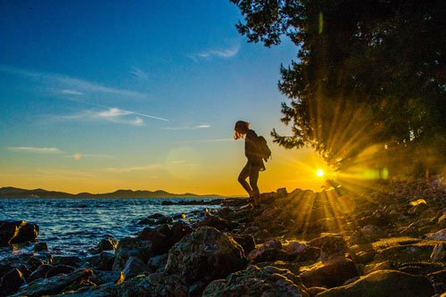 Sunset in Croatia - Zadar - woman in front of glaring sunlight