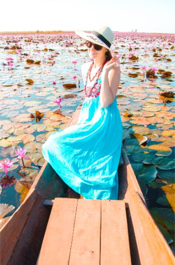 woman in blue dress at boat on Red Lotus Lake in Udon Thani