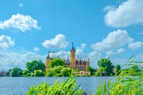 Schwerin Castle in North Germany seen across the lake
