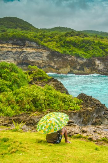 person with parasol at Broken Beach on Nusa Penida