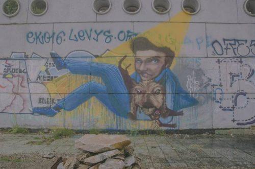 graffiti on the side of Buzludzha Monument in Bulgaria