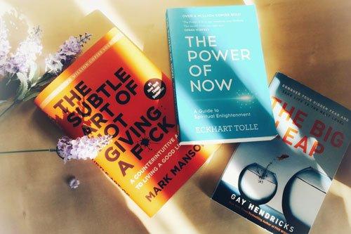 Mark Manson, Eckart Tolle and Gay Hendricks books