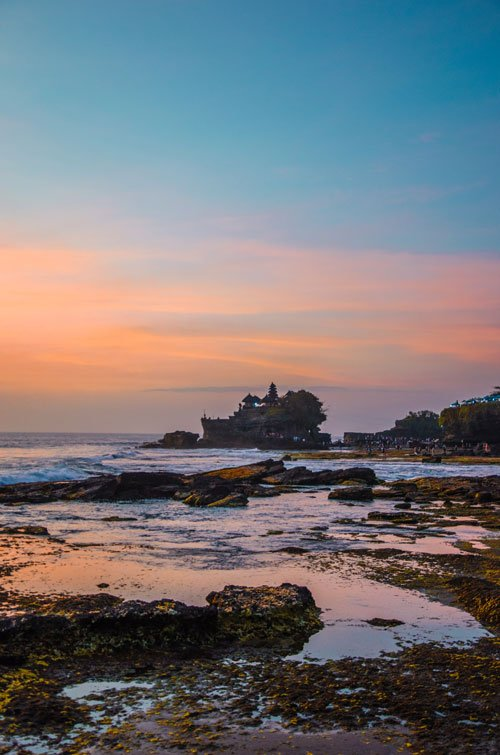 Pura Tanah Lot at sunset and low tide, Bali Indonesia