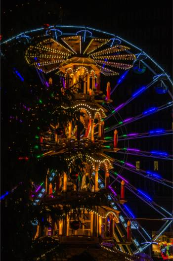 lit up ferris wheel of Christmas market in Jena, Germany, at night