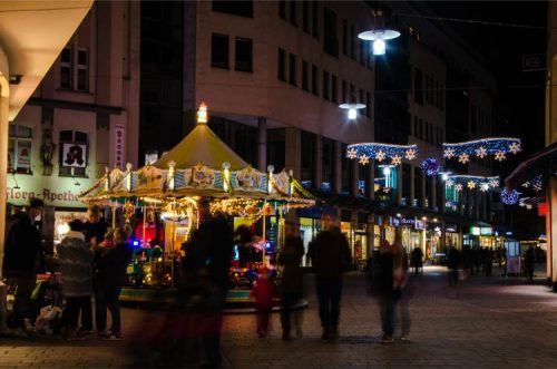 traditional merry-go-round along shopping streets of Jena during Christmas