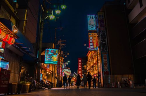Shinsekai streets illuminated at night, Osaka