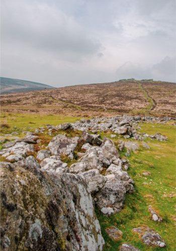 thick wall of Grimspound in Devon, UK