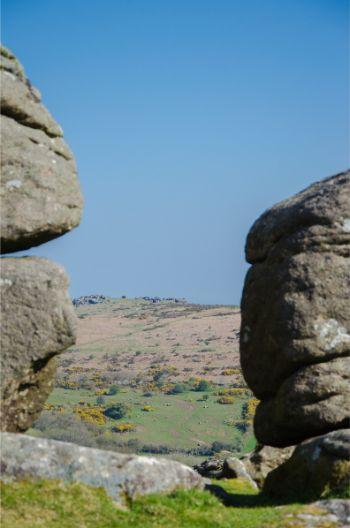 loking through rocks at Hound Tor in Dartmoor National Park, Devon, England