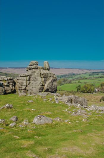 A sunny day with clear blue skies over Hound Tor in Dartmoor National Park, Devon, England