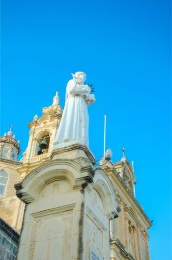 statue of a saint in front of Church of Saint Anthony of Padua
