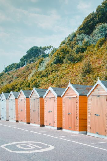 Bournemouth beach huts in orange and light blue