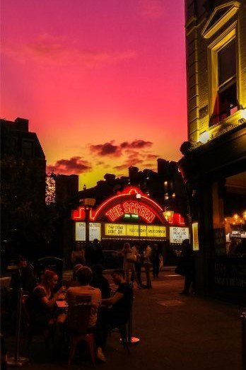 cinema at sunset with flaming red sky in Islington