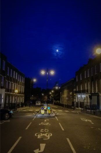 town houses at night in Islington underneath full moon