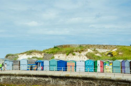 colourfully painted beach huts in Westgate-on-Sea, Kent, England