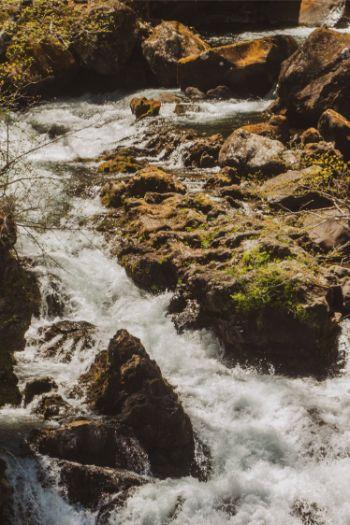 water streaming down rocks at Kegon Falls Nikko, Japan