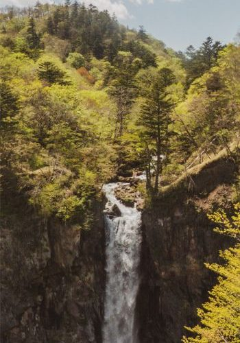 majestic Kegon Falls gushing down the cliff in Nikko, Japan