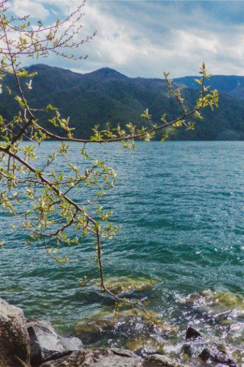blue Chuzenji Lake in Nikko, Japan, on a sunny but windy day