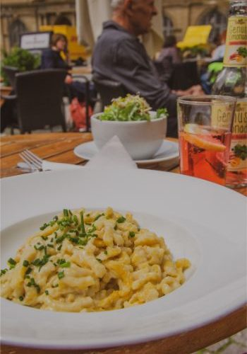 yellow spaetzle on a hit plate at a restaurant in Stuttgart