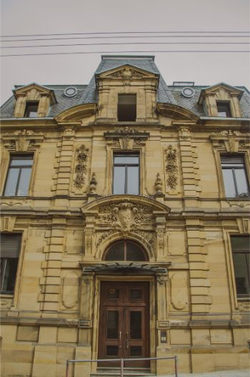 beautiful old building in the centre of Stuttgart made from yellowish stones and with a grey roof