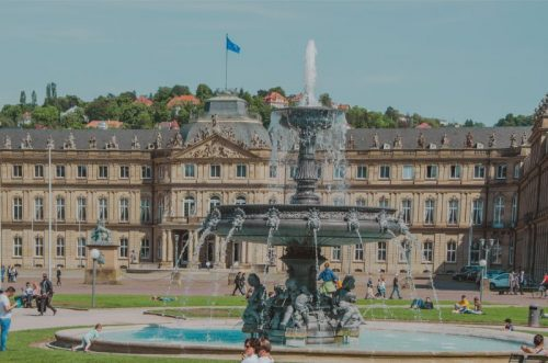 New Palace in Stuttgart with the fountain at Palace Square on a sunny day