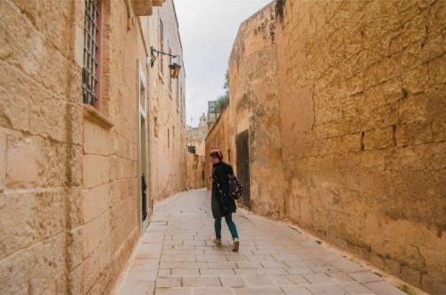 woman in alleyway of Mdina, Malta