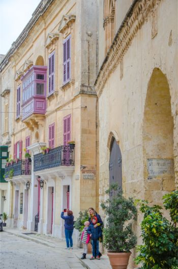 iron wrought balconies and red painted windows in Mdina, Malta