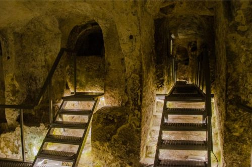 inside St Agatha's catacombs with stairs leading up to tombs, Rabat in Malta