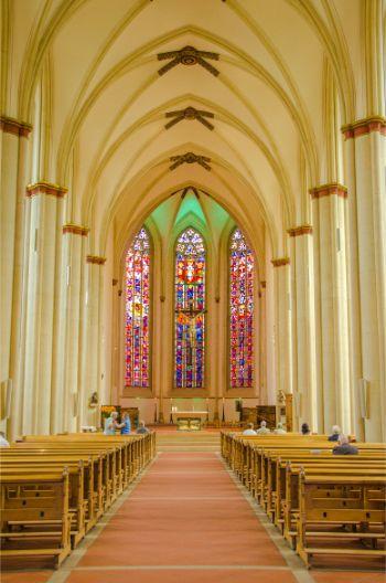 the sleek arches and colourful window mosaics inside the Überwasserkirche Münster