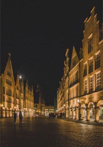 Prinzipalmarkt at night, illuminated in golden light