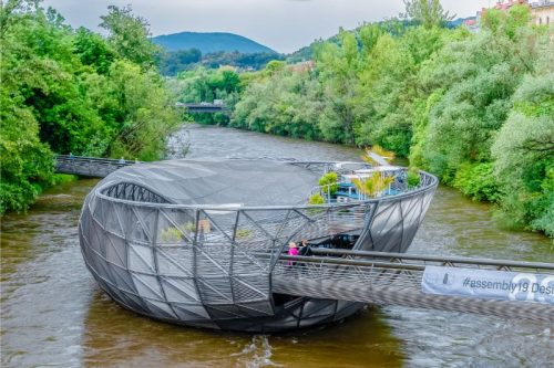 Murinsel in the river of Graz, a steel and glass construction in the shape of an oval