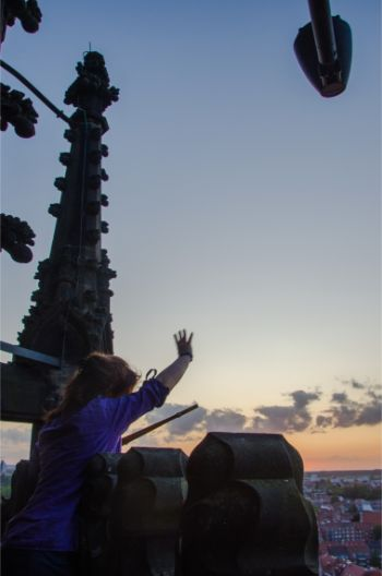 St Lamberti watchwoman waving at sunset