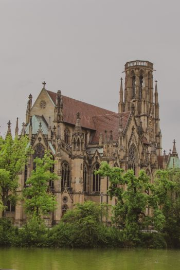 the Gothic building of St John's Church in Stuttgart, Germany