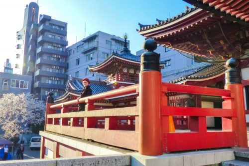 red railings with woman at Osu Kannon Temple