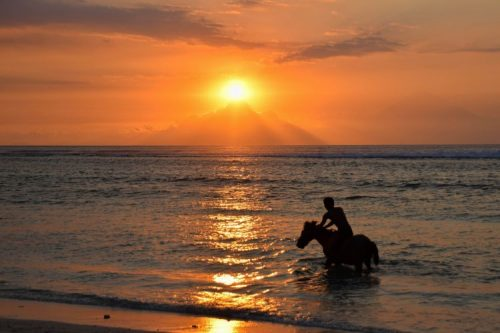 fiery red sunset over the Gili islands with view of Lombok