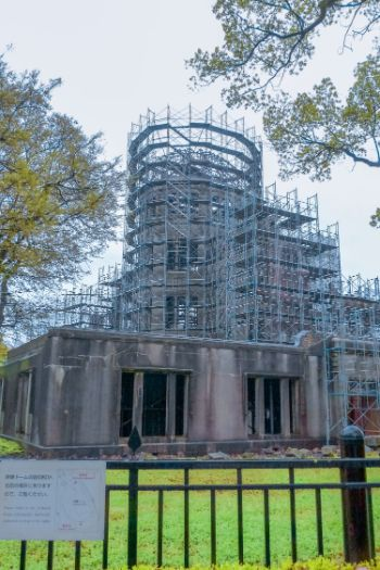close up of Atomic Bomb Dome in Hiroshima on a cloudy day and coverd by scaffolding, Japan