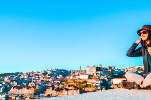 Porto skyline with woman sitting on a wall