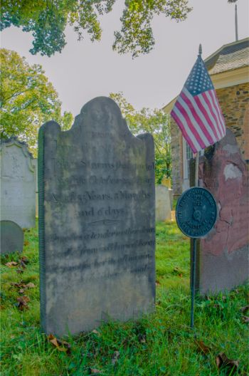 close up of grave stones with US flag at Sleepy Hollow cemetery NY