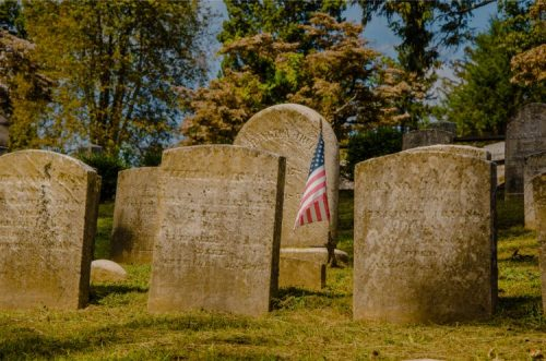 graves at the Sleepy Hollow cemetery with US American flag