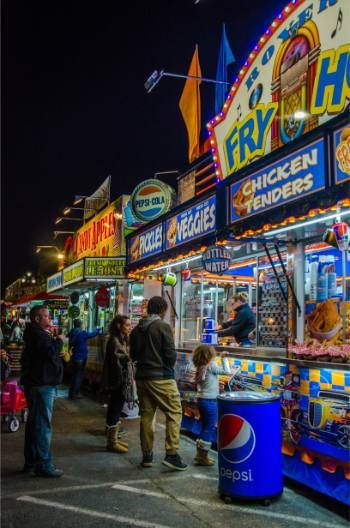 lit vendors at night of NC State Fair 2019