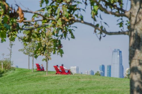 Red chairs on the Hills at Governors Island NY