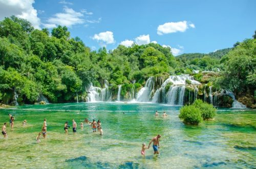tourists bathing at Krka National Park, Croatia