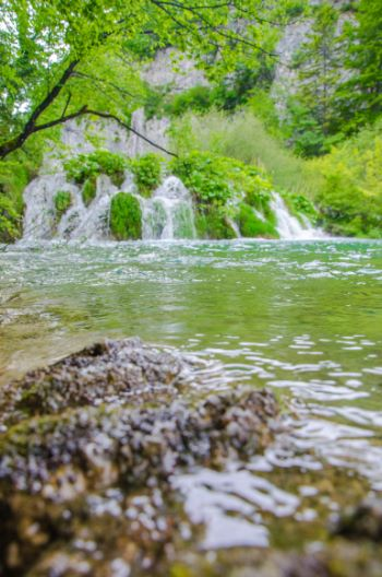 low angle view over lake and falls at Plitvice National Park, Croatia