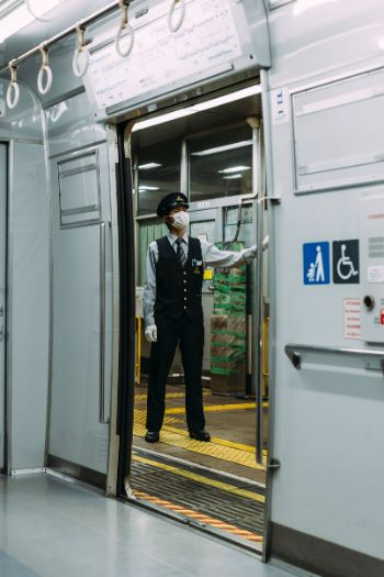 Japanese train conductor with mask